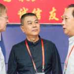 David and Li Fangfang listen to Yu Jianfang, director of the Chinese People's Liberation Army and composer of the college division required work.